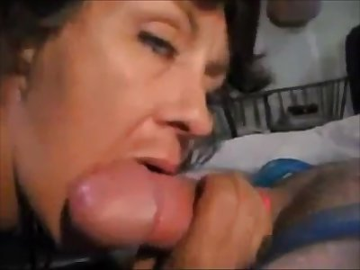 Sexy older lady sucking dick coupled with drink cum