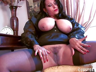 Provocative mature Danica Collins spreads her legs to masturbate