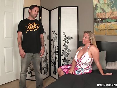 Beamy mommy loves holding the stepson's cock in her hands
